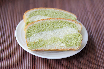 a close-up of two slices of matcha milk bread on a plate