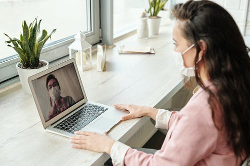 Woman Having An Online Consultation with a Doctor
