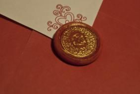 A piece of Sculpey embossed with Swiss coin, recarved and painted with acryllic