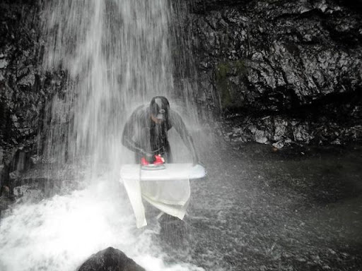 Extreme Ironing Under A Waterfall