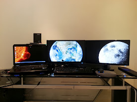Built-in display plus two monitors functioning as one 3840x1080 monitor
