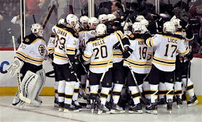 The Bruins celebrate as they won game 4 in overtime