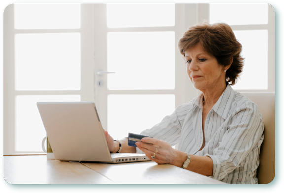 A woman sitting at a laptop, looking upset.