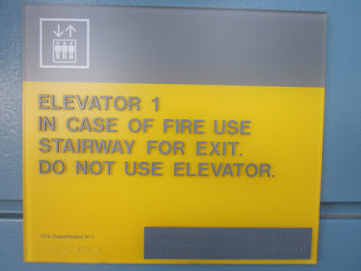 Elevator sign fire braille photo