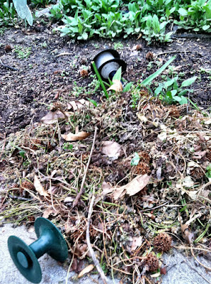 Solar lights broken leaves dirt yard photo