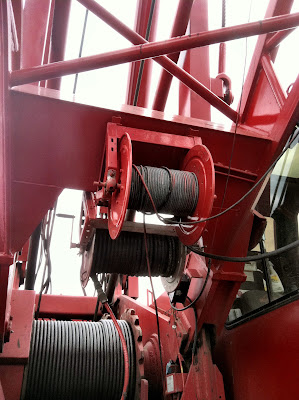 Crane cable spooled boom arm red photo