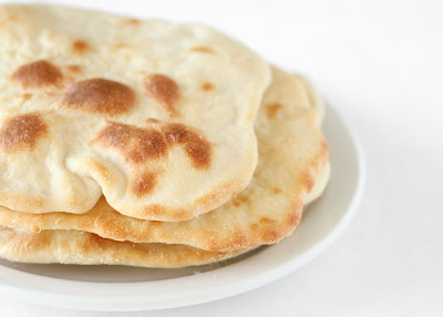 close-up photo of three pieces of naan