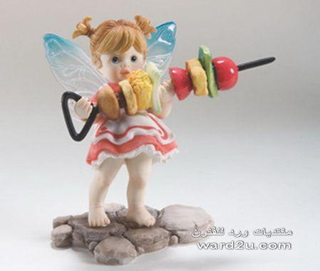 ملاك صغير فى مطبخى باجنحه شفافه