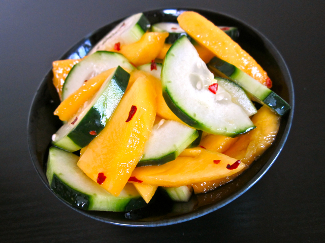 Pour the dressing over the cucumber and mango. Stir well before ...