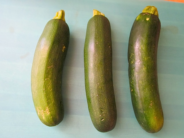 three whole washed zucchini