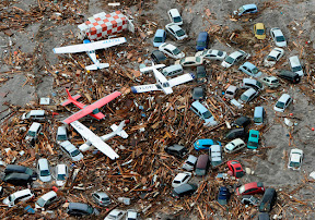 Cars and airplanes swept by a tsunami are pictured among debris at Sendai Airport, northeastern Japan on March 11.