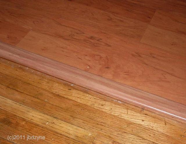 Laminate Floor next to old oak floor
