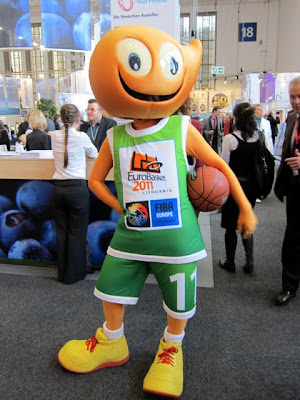 Mascot with a basketball at the ITB Berlin Travel Trade Show in Germany