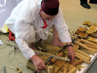 Man carving wood at the ITB Berlin Travel Trade Show in Germany