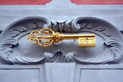 Golden key on a wall in Prague Czech Republic