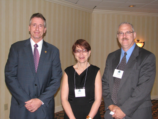 Photo of Lt. Governor Duffy, CDFI Coalition Coordinator Melanie Stern, and Pathstone Vice President for Small Business Lending Dana Brunett.