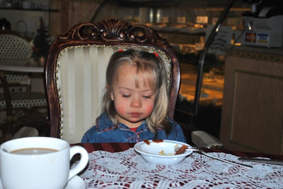This is a photo of Arabella in Michi's Strudel Cafe sitting in an upholstered armchair.