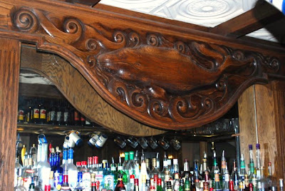 This is a photo of the carving of a whale over the bar in the Whale and Ale pub in Port San Pedro, CA.