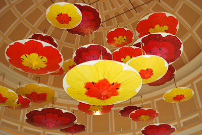 This is a photo of hand painted umbrellas hanging from various wires in the ceiling of the Bellagio Hotel and Casino in Las Vegas, NV.
