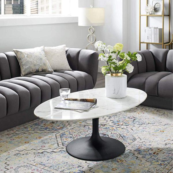 http://cdn.home-designing.com/wp-content/uploads/2021/04/luxury-oval-shaped-coffee-table-with-matte-black-pedestal-base-artificial-marble-top-contemporary-living-room-furniture-ideas-600x600.jpg