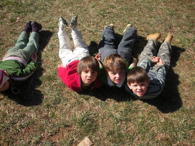 Thumbs-Up Kids doing Locust pose