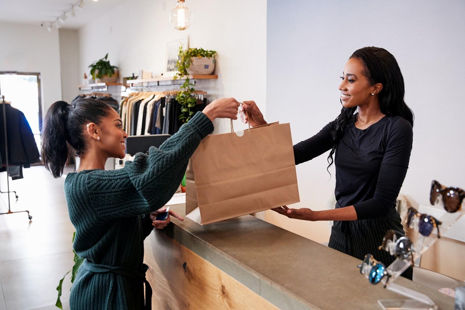 how to get customers in the door woman purchasing