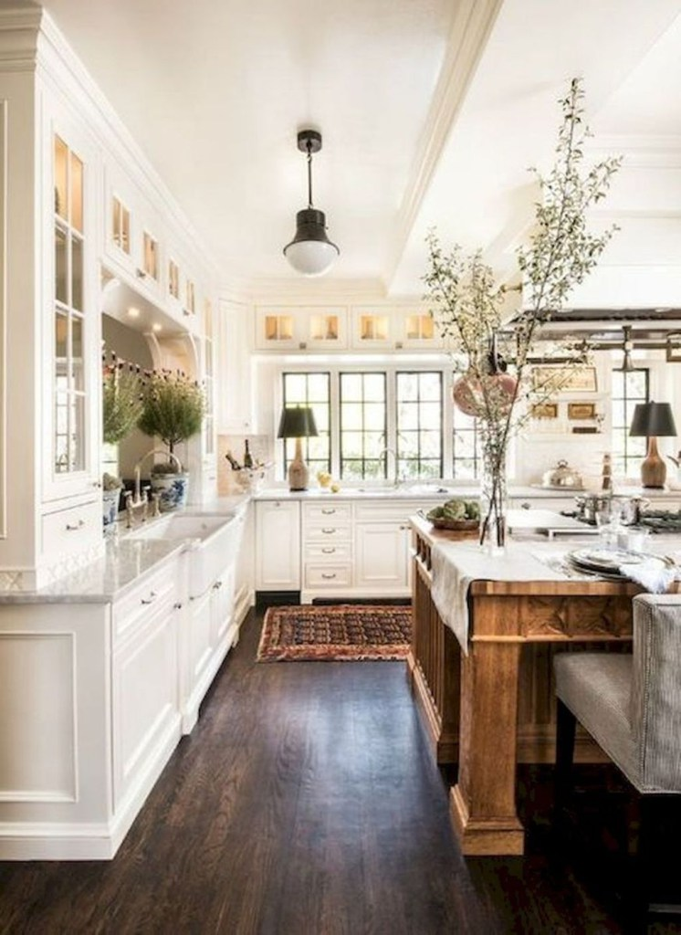 one of the most common and impactful elements of a modern farm style kitchen is a wood wall made with reclaimed wood or shiplap the look made popular by - Modern Farmhouse Kitchen