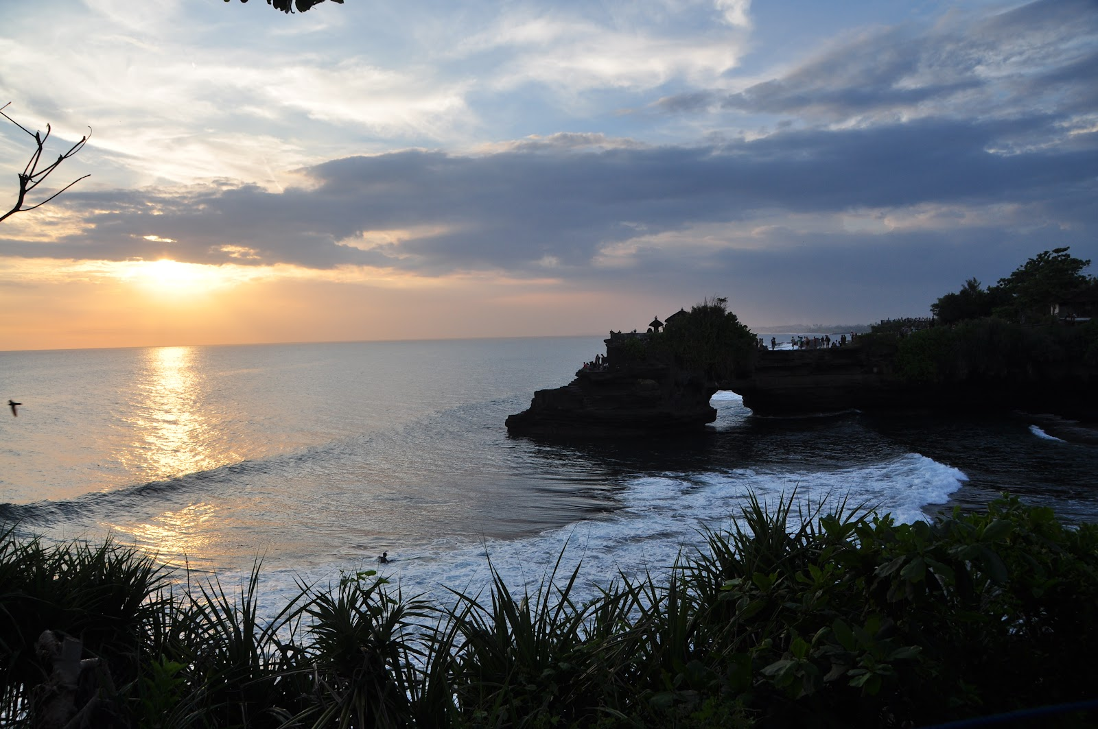 tanah lot buddhist temple next to ocean during sunset