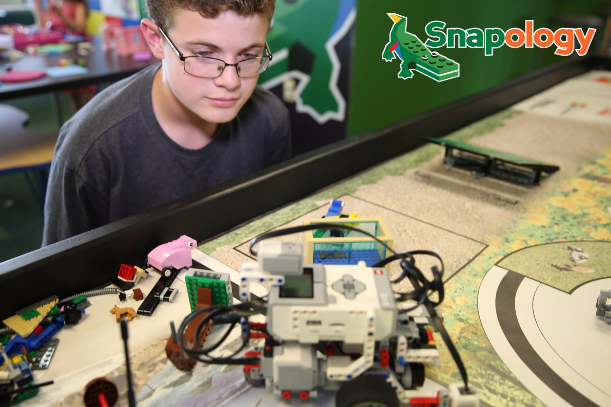 young teenage boy looking at LEGO Robotics
