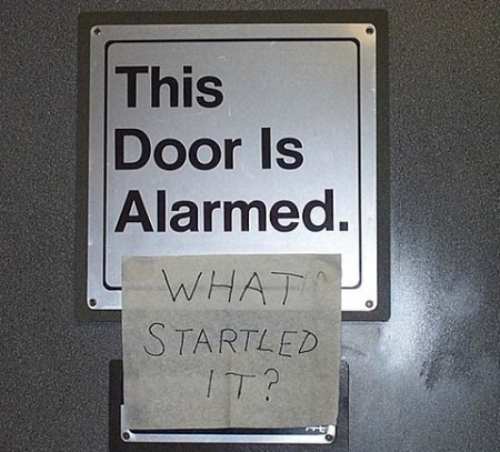 photo of a note on a door...the door is alarmed, what startled it