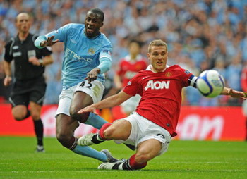 Toure with Vidic, Manchester City - Manchester United