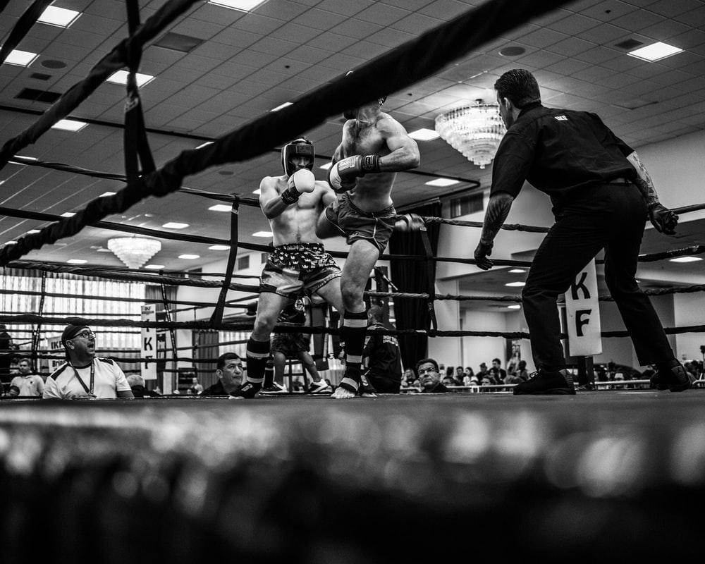 grayscale photo of mix martial arts fight