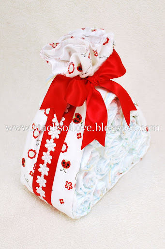 Diaper Cake Stork Bundle with Ladybug theme wrapped in blanket