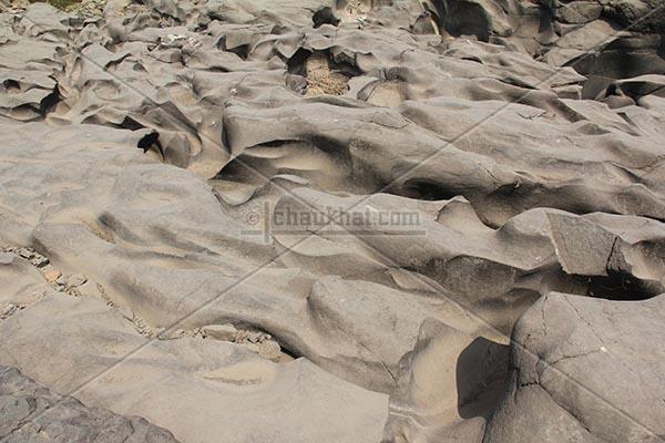 Potholes - Flow of rocks