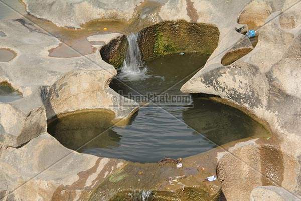 Water flowing in mini pond of potholes