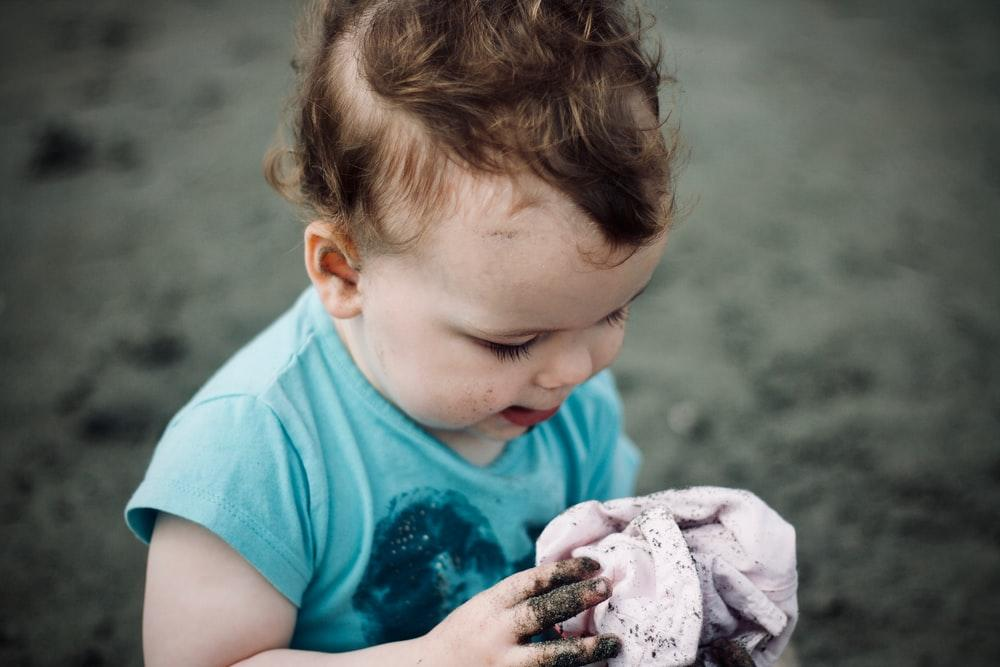 baby holding a cloth