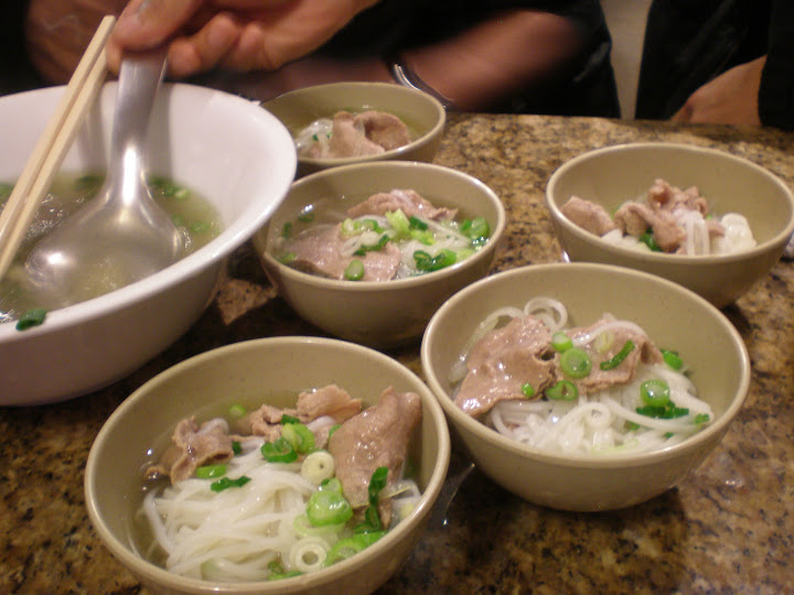 Dividing up an extra-large bowl of pho at Golden Turtle