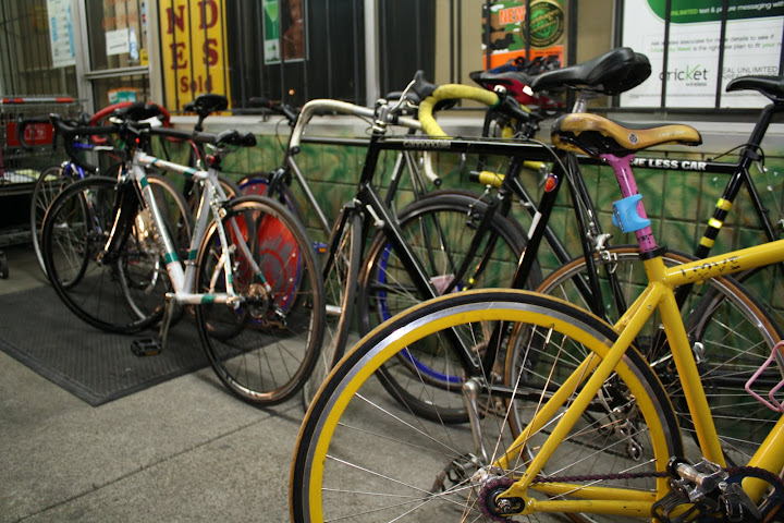 Colorful bicycles parked next to a colorful wall