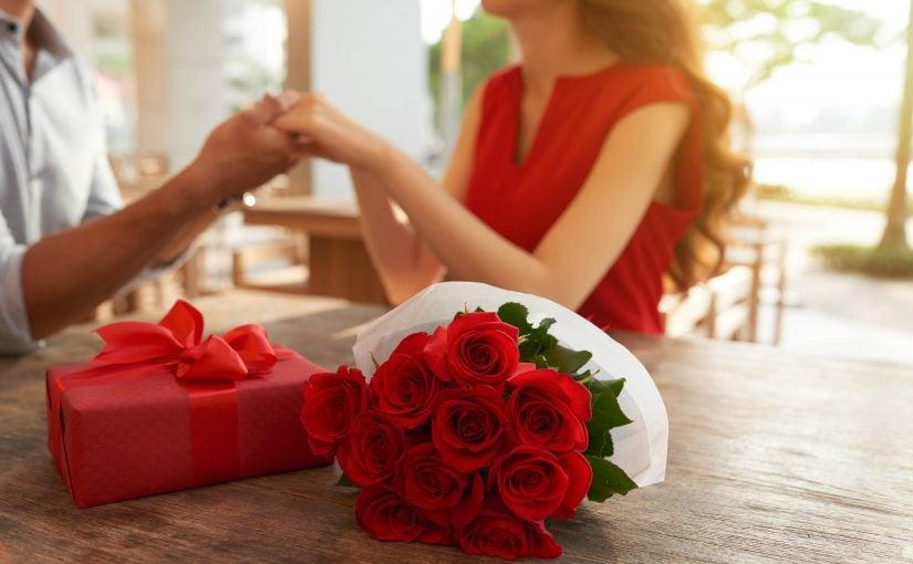 A person holding a bouquet of red rosesDescription automatically generated with low confidence