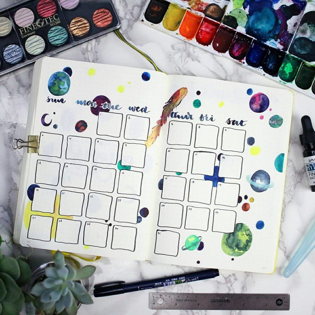 A watercolor space scene used on a calendar