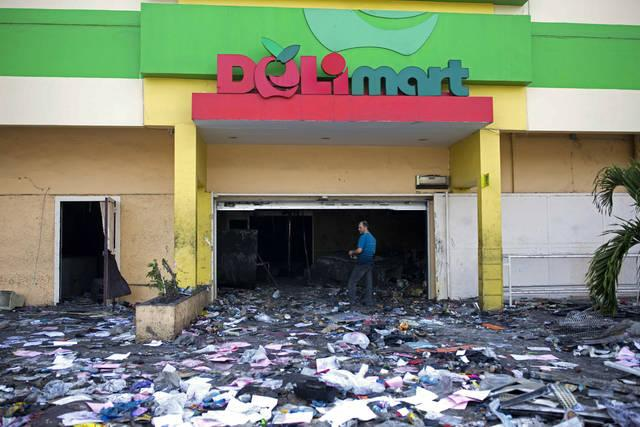 Image result for supermarket boulos burned july 7,8 2018 haiti photos