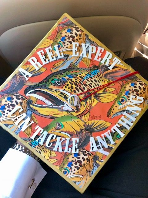 """A graduation cap that reads """"A reel expert can tackle anything."""""""