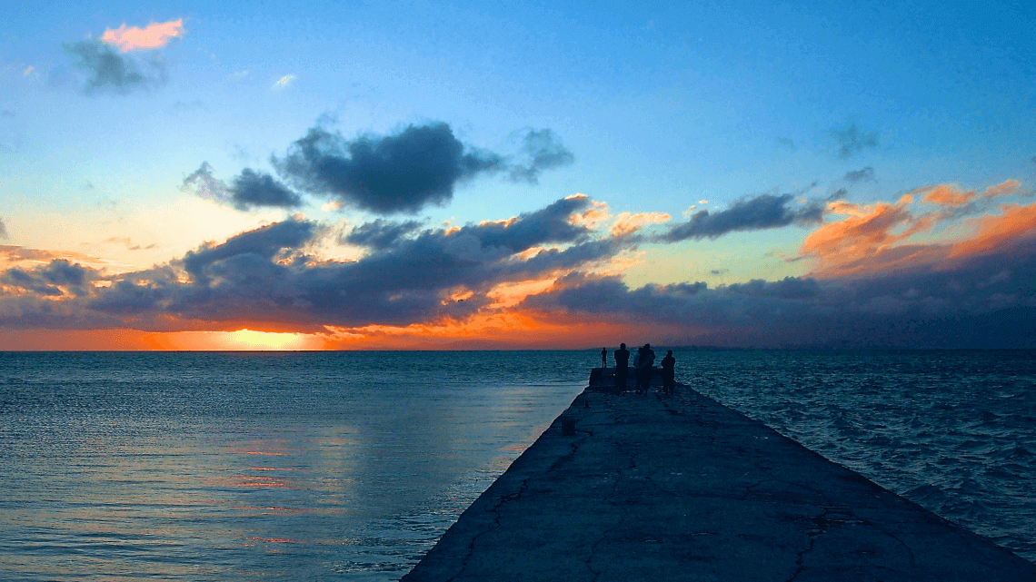 Sunset views from the pier at HOSHINOYA by Hoshino Resorts, Taketomi Island, Okinawa, Japan