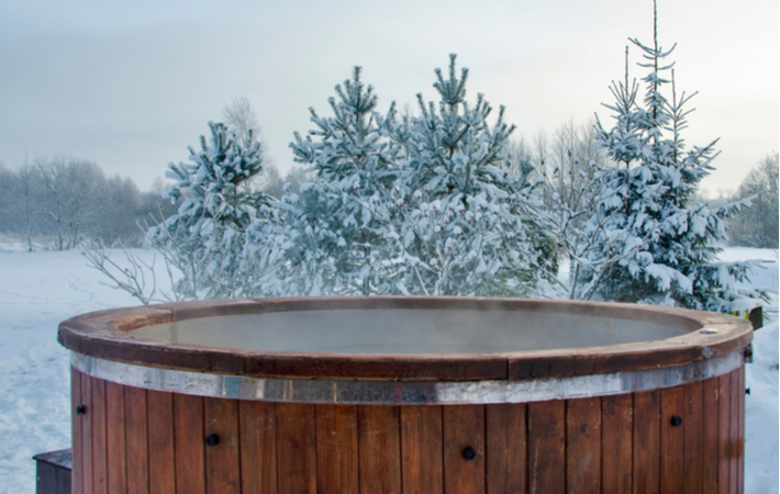 wooden spa hot tub outdoors in winter