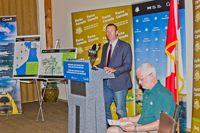MP of the Macleod riding, John Barlow, announces $107 million grant for upgrades in Waterton Lakes National Park. Ifan Thomas, superintendent of the park opened the press conference and introduced Barlow.