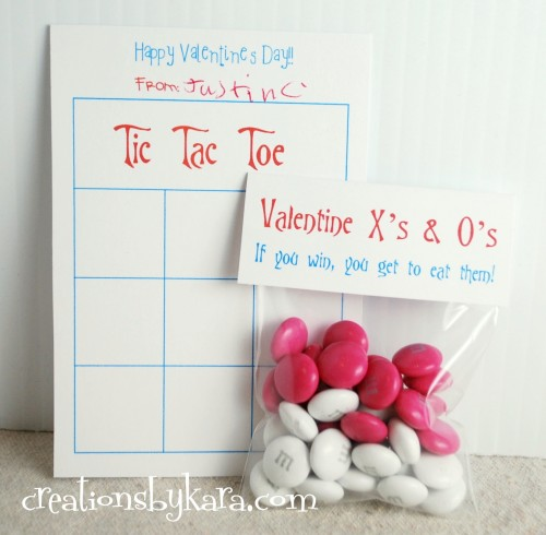 """Tic Tac Toe Board with a cellophane bag containing pink and white M&Ms and a card that says, """"Valentine X's & O's. If you win, you get to eat them!"""""""