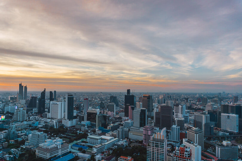 Sunset over Bangkok's skyline from a roof top bar.
