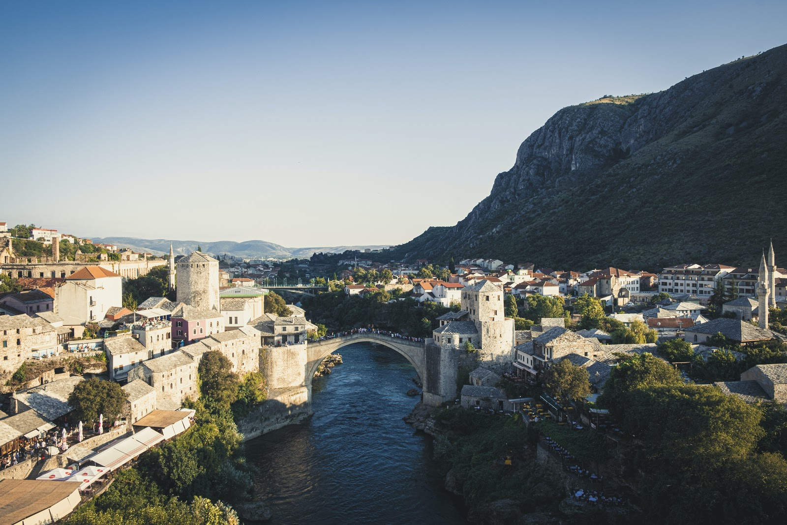 With beautiful blue skies, the picture is a view from above of stunning Mostar with the famous bridge take centre stage.