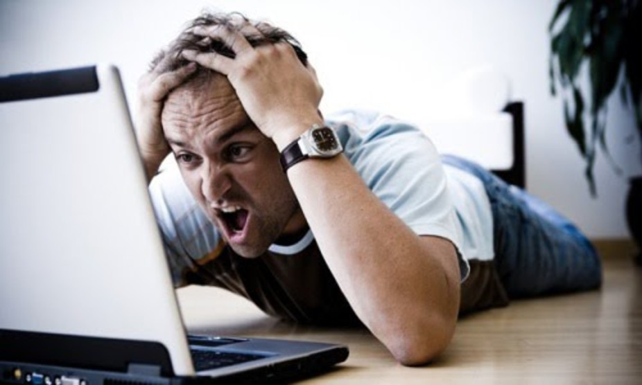 frustrated designer at laptop