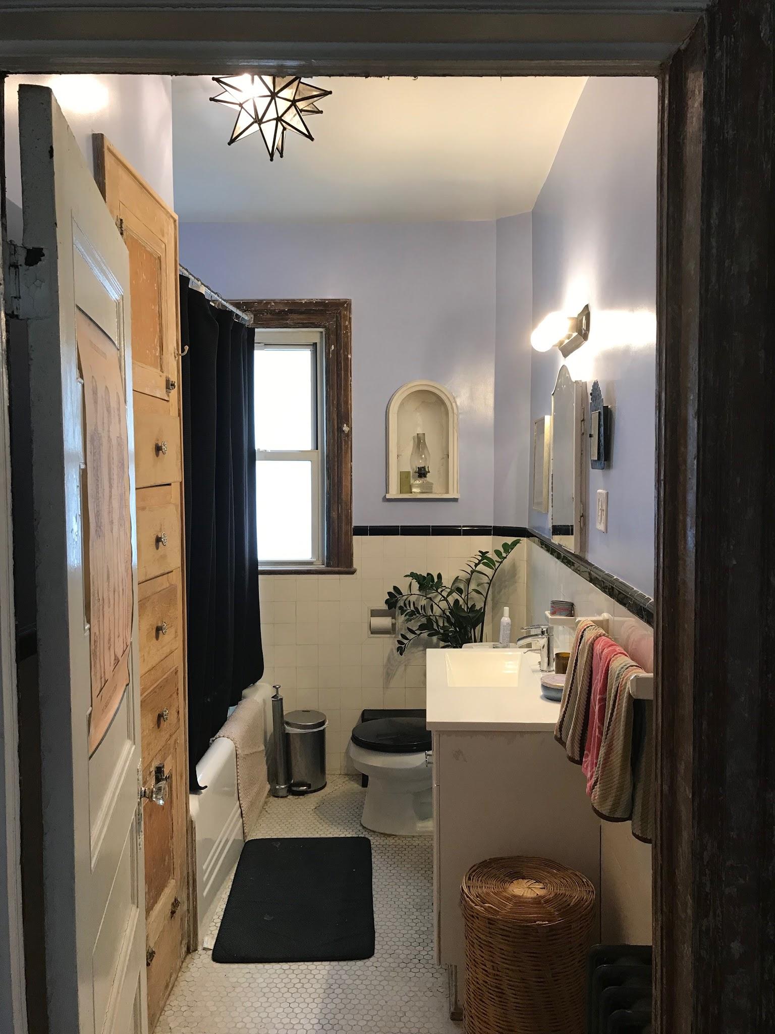 Black+white subway tile bathroom with full tub + lots of storage